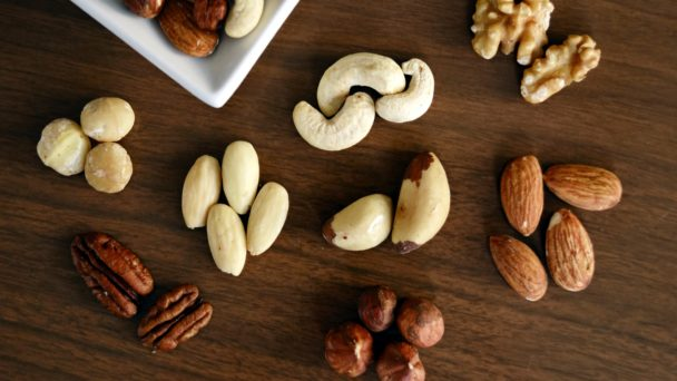 variety-of-brown-nuts-on-brown-wooden-panel-high-angle-photo